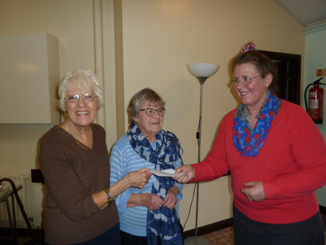 Anne-Marie presents Janet and Maureen with a donation for Fenprobe funds.
